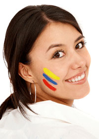 Smiling woman with colombian flag painted on her face